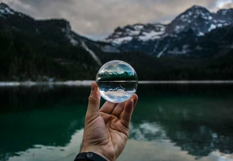Lake Reflection One Person Crystal Ball Human Body Part Mountain Water Holding Close-up Outdoors Human Hand Nature First Eyeem Photo live outdoors Live For The Story The Great Outdoors - 2017 EyeEm Awards