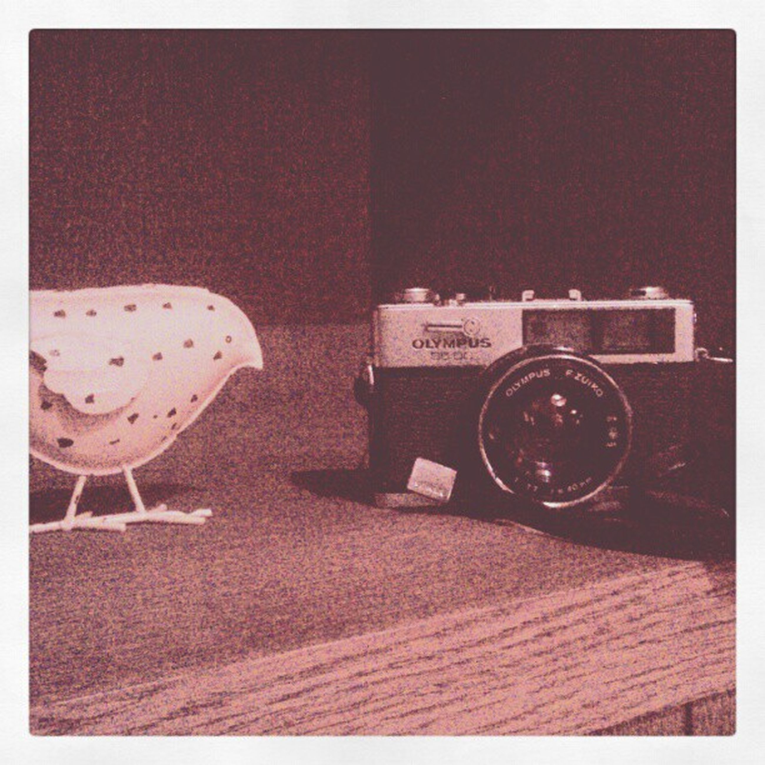 transfer print, auto post production filter, table, still life, indoors, old-fashioned, close-up, no people, retro styled, wood - material, toy, absence, single object, high angle view, day, copy space, technology, red, land vehicle, glass - material