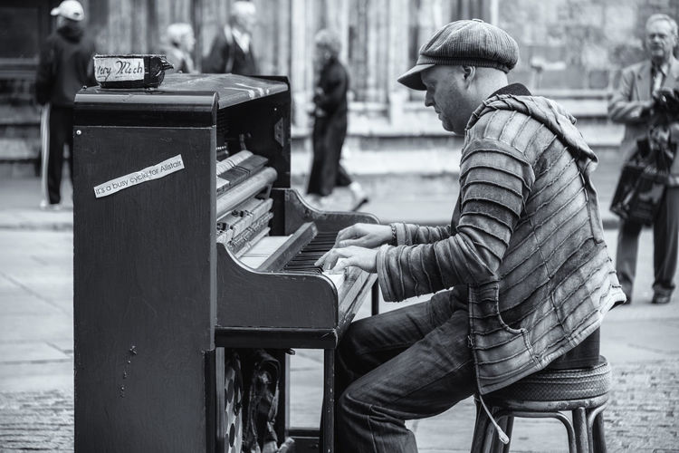 Piano busker on the street in York, England, UK Black And White Blackandwhite England Hat Man Monochrome Outdoors People People Photography People Watching Piano Piano Keys Piano Moments Piano Player Playing Scarf Street Streetphotography Travel Travel Destinations Travel Photography Uk York Yorkshire Busker
