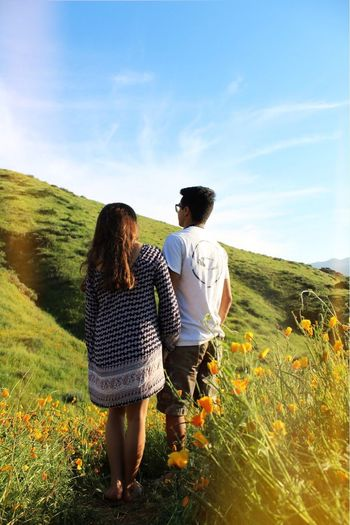 Rear View Togetherness Two People Real People Bonding Love Leisure Activity Lifestyles Nature Walking Full Length Field Sky Grass Poppies