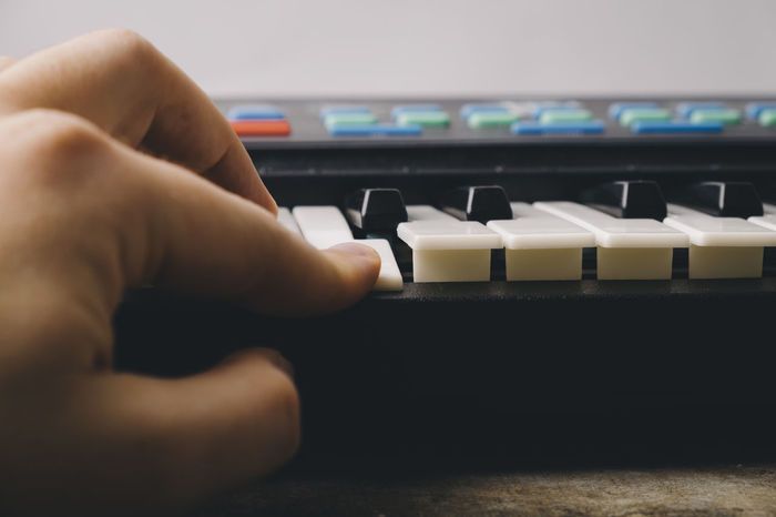 Keyboard synthesizer Black Buttons Close-up Composer Electro Human Body Part Human Hand Indoors  Instrument Key Keyboard Instrument Man Music Note One Person Piano Player Playing Real People Song Songwriter Synthesizer Technology White Wood - Material