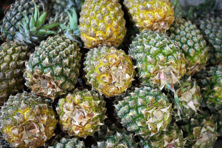 Full frame shot of pineapples for sale in market