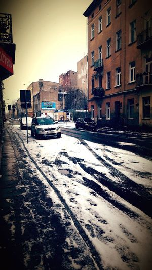 Building Exterior Car Built Structure Architecture Transportation Land Vehicle Mode Of Transport Outdoors No People Cold Temperature Cityscape These Streets Łódź Poland Back Home ♥ Street Photo Snow Melting Snow