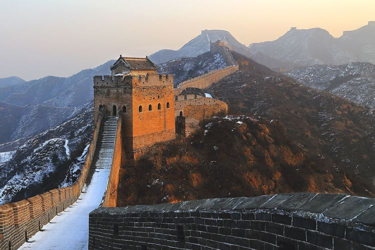 EyeEmNewHere Great Wall Of China Ancient Architecture Architecture Built Structure Cold Temperature Day History Mountain No People Outdoors Scenics Snow Sunrise Travel Destinations Winter