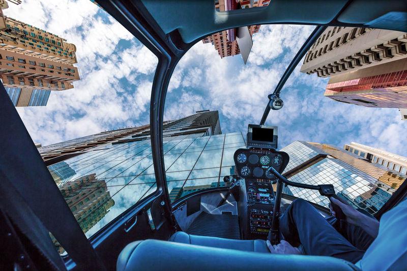 Panoramic view of city seen through car window