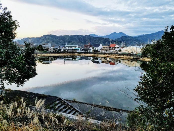 Near the center of a large city, some peace at sunset. Cityscape Phonetography Cellphone Photography Shizuoka-shi Japan Mountain Reflection Water Cloud - Sky Mountain Range Sky Lake