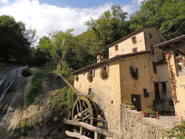 Molinetto Della Croda Architecture Beauty In Nature Building Exterior Built Structure Cloud - Sky Day Field Nature No People Old-fashioned Outdoors Sky Tree Water Wheel