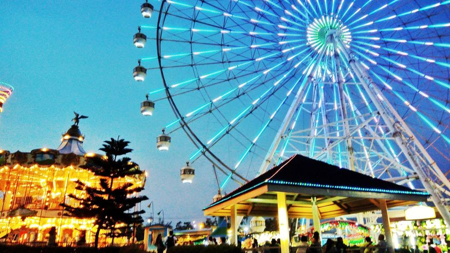 Amusement Park Sky Ferris Wheel Amusement Park Ride Architecture Arts Culture And Entertainment Low Angle View Outdoors Leisure Activity Built Structure Blue Day Carousel First Eyeem Photo