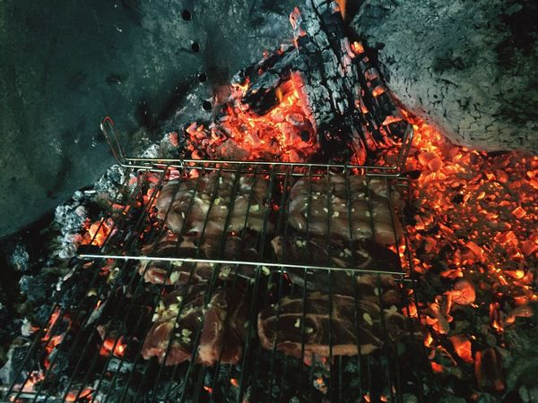 Cooking meat on an ancient chimney Heat - Temperature Flame Barbecue Grill Burning Barbecue Coal Preparation  Food Food And Drink No People Smoke - Physical Structure Close-up Freshness Woodsteak Wood Meat Old Ancient Rural Scene Country Life Food And Drink Celebration Flame Fire Firecamp