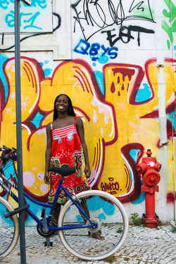 Street Art Bicycle Outdoors Day Built Structure Multi Colored One PersonStreet City People City Adult One Woman Only Adults Only Paint The Town Yellow