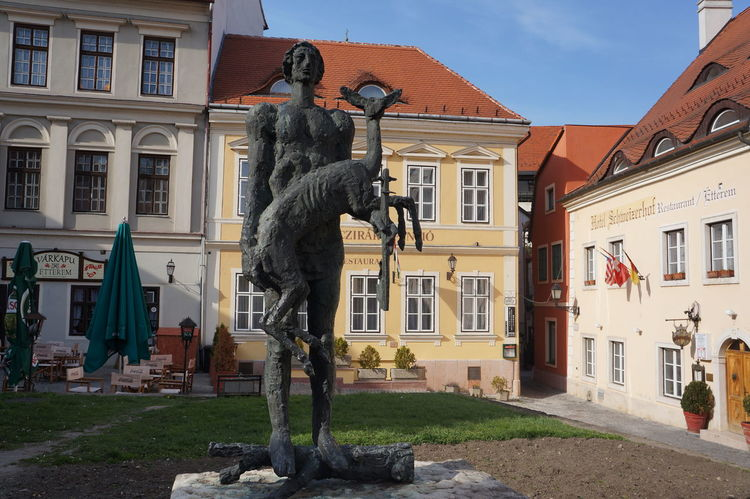 Animal Representation Architecture Art Art And Craft Building Building Exterior Built Structure City Creativity Day Győr Human Representation Hungarian Hungary Incidental People Outdoors Sculpture Sky Statue Street Window