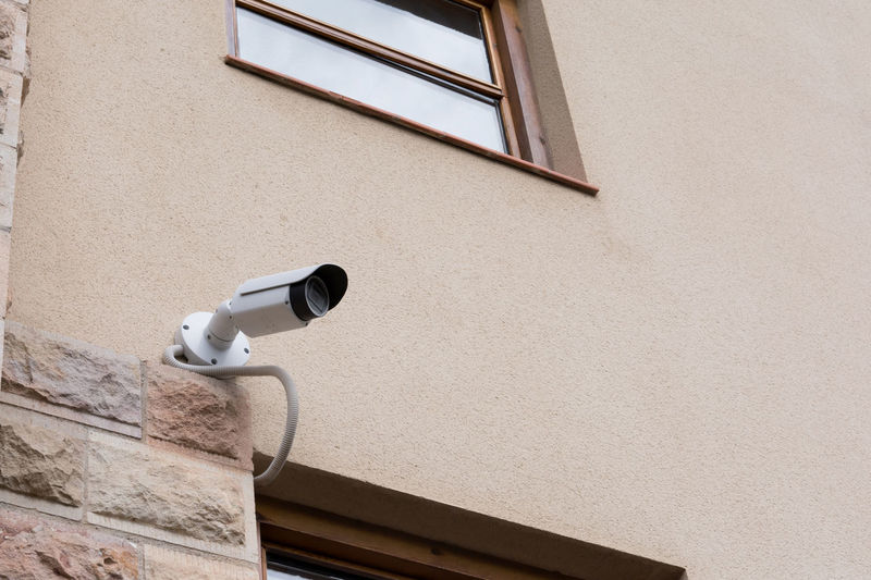 security CCTV camera on the concrete wall with copy space Camera Home Office Security Architecture Built Structure Cam Close-up Concrete Control Control Panel Day Guard Monitor Outdoors Photography Themes Protection Record Safety Security Security Camera Surveillance Technology Wall Window