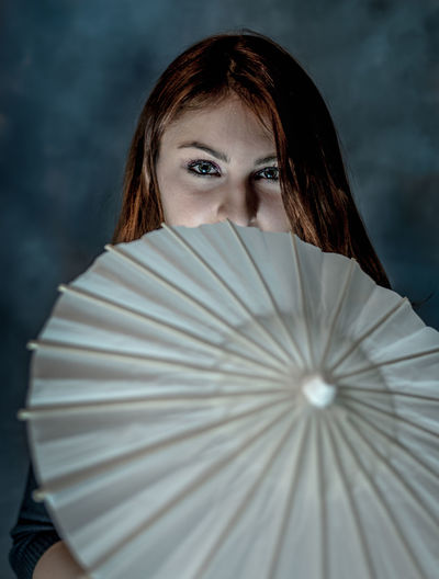 Portrait of woman with drink umbrella