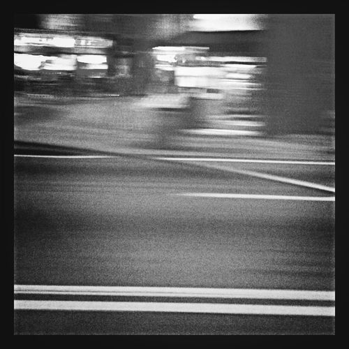 Blurred motion of cars on street