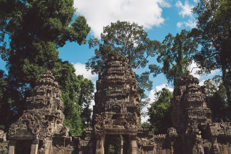 Siem Reap Cambodia Angkor History The Past Architecture Place Of Worship Ancient Built Structure Religion Belief Tree Travel Destinations Travel Plant Spirituality Tourism Old Ruin Old Building Exterior Nature No People Ancient Civilization Outdoors Archaeology Ruined