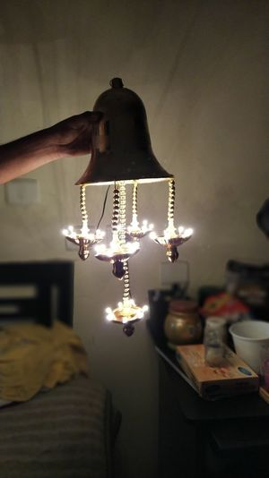 Illuminated lamp post on table at home