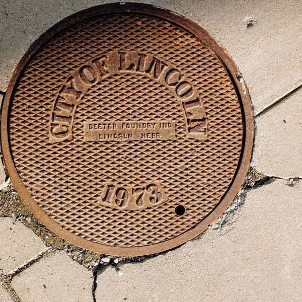 Visual Journal May 2018 Lincoln, Nebraska 35mm Camera A Day In The Life Camera Work EyeEm Best Shots FUJIFILM X100S Getty Images Lincoln Nebraska Lincoln, Nebraska Manhole Cover MidWest Nebraska Photo Essay State Capitol Visual Journal Always Taking Photos Circle Close-up Communication Day Design Directly Above Downtown District Eye For Photography Floortraits Footpath From Where I Stand Fujifilm Geometric Shape High Angle View Lid Manhole  Metal No People On The Road Outdoors Pattern Photo Diary S.ramos May 2018 Sewage Shape Street Text Travel Destinations Western Script