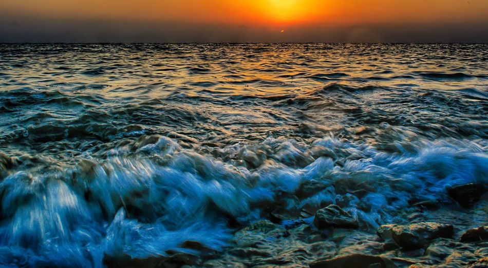 Sea Beauty In Nature Nature Sunset Water Orange Color Wave Scenics Tranquility Tranquil Scene No People Horizon Over Water Outdoors Sky Motion Day