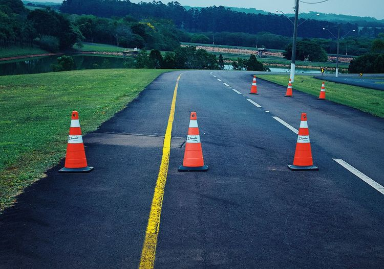 Sign Road Cone Traffic Cone Transportation Symbol Day Safety Communication Asphalt Road Marking Guidance Marking Direction No People Security Street The Way Forward Outdoors