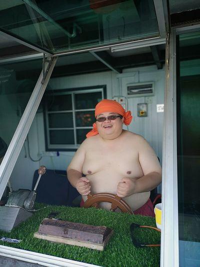 Full length of shirtless man looking away