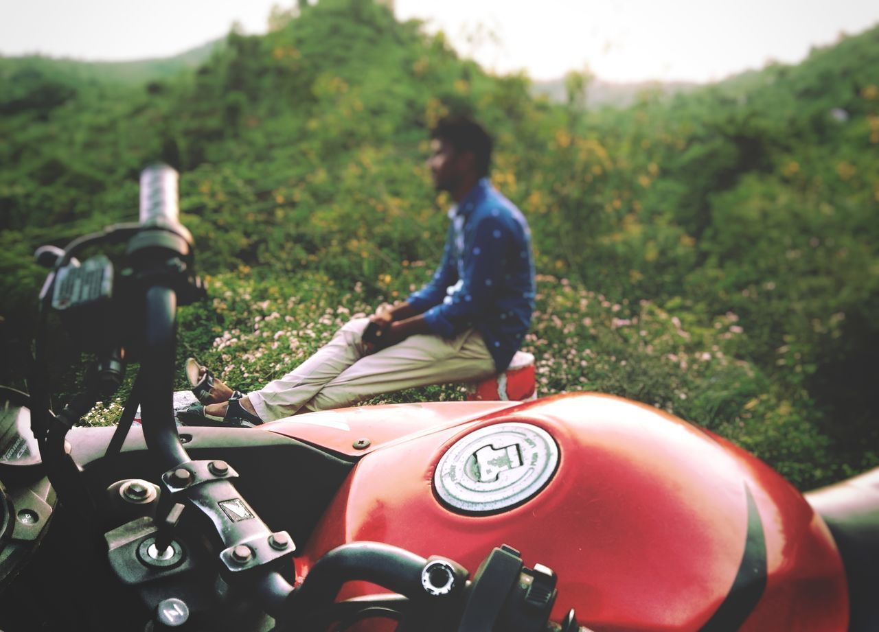 land vehicle, motorcycle, real people, mode of transportation, one person, day, transportation, plant, field, land, lifestyles, men, nature, leisure activity, grass, focus on foreground, helmet, outdoors, casual clothing, riding