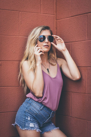 One Young Woman Only Long Hair Women Individuality Blond Hair Standing Beautiful People Purple Beautiful Woman Fun Adults Only Young Adult Only Women Sunglasses Human Body Part Headshot One Girl Only Front View
