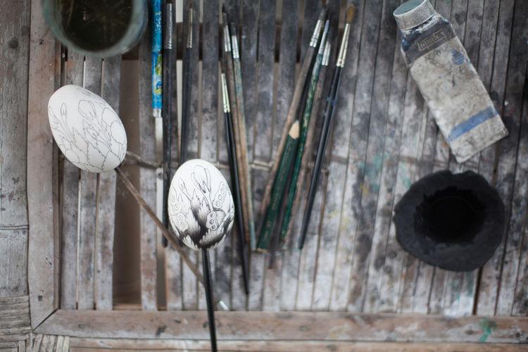 Creative eggs against paintbrush on table