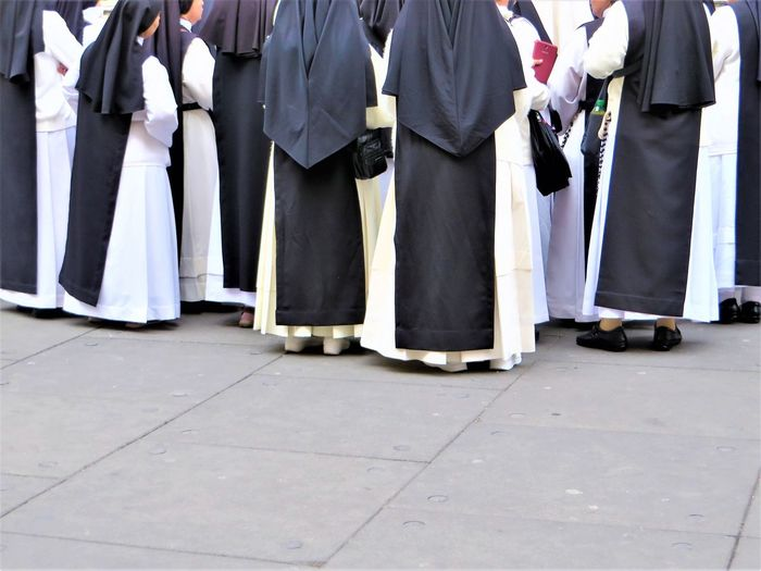 Low section of nuns standing on street