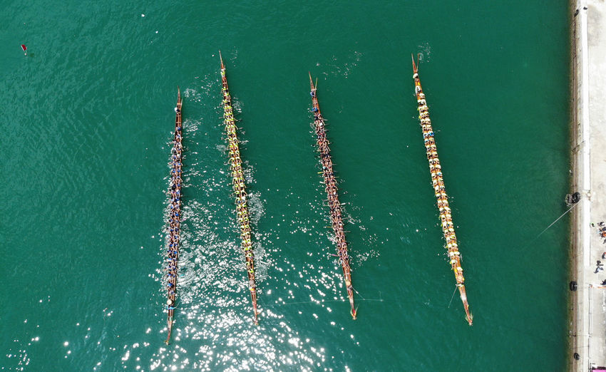 dragon boat racing in sham kei wan Dragon Boat Festival Dragon Boat Dragon Boat Race Race Contest Sport Sea Traditonal Traditional Festival Hong Kong China Chinese Festival Boat Canoeing Canoe Waterfront High Angle View Drone Photography Dronephotography Droneshot Aerial View