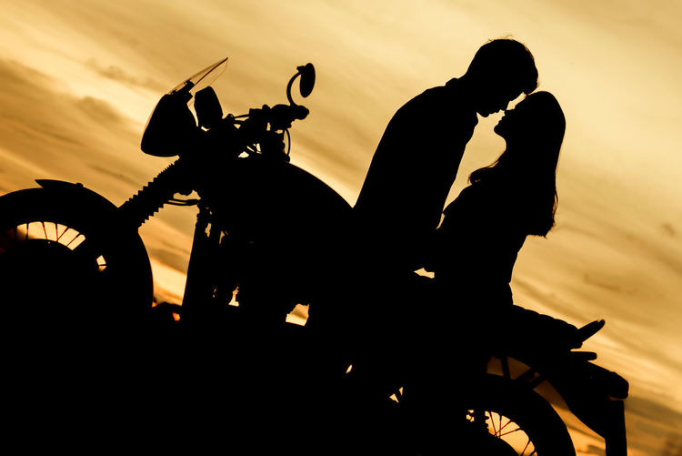 Silhouette Lover Hug Kiss Lover Silhouette Leisure Activity Lifestyles Male Female Nature Orange Color Outdoors Real People Ride Motorcycle Riding Silhouette Sky Sunset Twilight Skyline