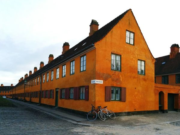 Orange House Little Boxes Old House Copenhagen Building Exterior Transportation Built Structure Architecture Mode Of Transport Sky Outdoors Bicycle Window Land Vehicle Day No People City