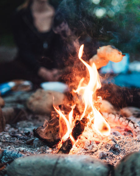 Evening campfire with friends Burning Flame Heat - Temperature Fire Fire - Natural Phenomenon Wood Nature Close-up Log Environment Glowing Wood - Material Bonfire Firewood Selective Focus Land Motion Outdoors Event Orange Color Campfire Friendship Friends