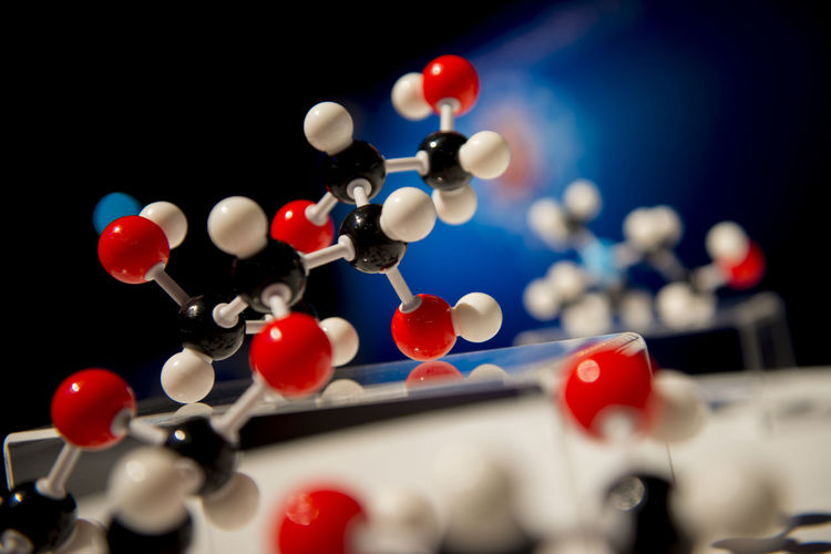 Close-up of molecular structures on table in laboratory