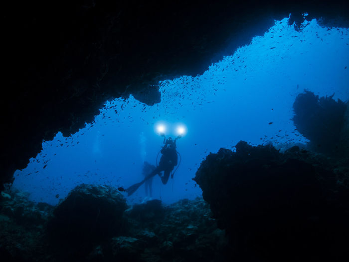 People scuba diving in sea