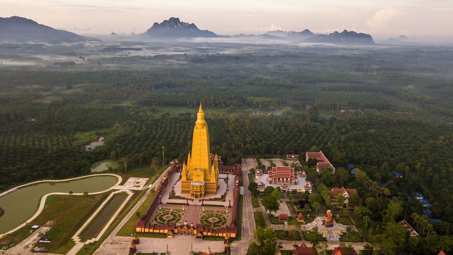ASIA Nature Background Agriculture Morning Drone  Architecture Temple Thailand View Asian  Building Art Buddhist Old Landmark Gold Aerial Landscape Buddha Clouds Culture Countryside Blue Buddhism Religion Beautiful Travel Rice Top Fields Sky Green Photo Tourism Trees Wat Built Structure Building Exterior Belief Place Of Worship Spirituality Tree Mountain Travel Destinations Plant No People Scenics - Nature Day Outdoors Cityscape Spire
