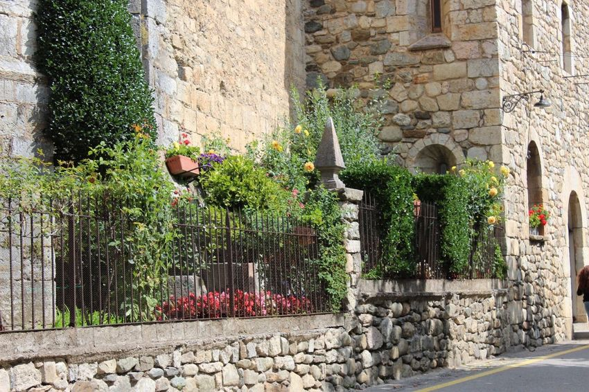My Favorite Place Architecture Building Exterior Built Structure Wall Wall - Building Feature Stone Wall Flower Plant Stone Day Growth Garden Outdoors Stone Material Place Of Worship History Pot Plant Narrow Red In Front Of Camprodon Girona Gironamenamora SPAIN