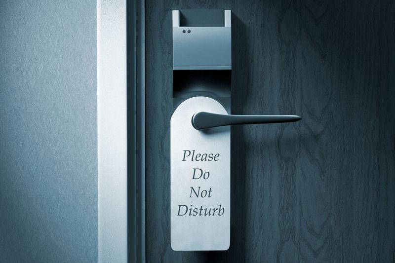 Close-up of do not disturb sign on door handle