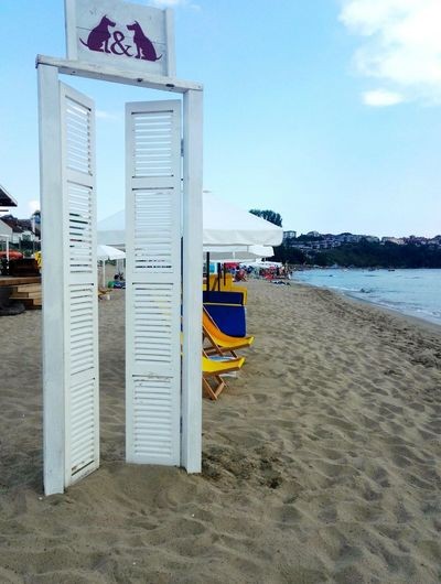 Door on the beach Dog White Door Sea Beach Water Sand Summer Sky Lifeguard  Calm