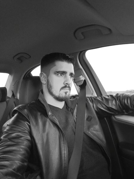 Young Men One Person Car Car Interior Adults Only Only Men Young Adult Vehicle Interior Men One Man Only Adult People Film Noir Style Warm Clothing Day Outdoors French