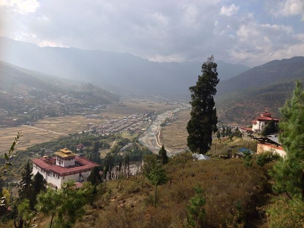 looking back at the view from where i lived in Bhutan. Mountain Landscape Remote Territory Wilderness Area Himalayas Mountain Range Rural Village Hillside View Tranquility Idyllic Scenery Daytime Rugged Outdoors High Elevation High Altitude Terrain Dense Forest Pine Trees Dramatic Sky River And Valley Wanderlust Getting Inspired Exotic Destination Bhutan Gross National Happiness I Want To Be There Perfect View Showcase July