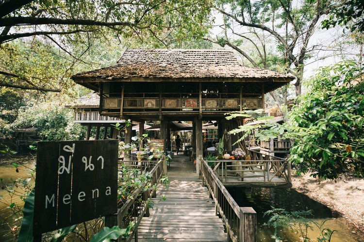 Tree Text Plant Built Structure Architecture Communication Day Nature No People Script Non-western Script Sign Western Script Water Forest Direction Information Wood - Material Outdoors Growth
