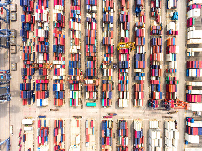 Aerial view of large cargo holding area in shipping yard. Abundance Aerial View Architecture Backgrounds Cargo Container Choice Container Day Freight Transportation Full Frame In A Row Industry Large Group Of Objects Multi Colored No People Outdoors Shelf Shipping  Stack Top View Transportation Variation