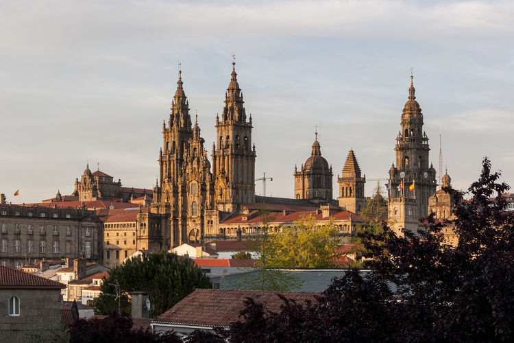 Santiago de Compostela 012 Travel Destination Galicia, Spain Santiago De Compostela Saint Jacques De Compostelle UNESCO World Heritage Site Way Of Saint James Camino De Santiago Pilgrimage Pilgrimage Site Tourism Tourist Attraction  Religious Architecture Catedral De Santiago De Compostela Cathedral Catholicism Catholic Faith Roman Catholic Cathedral Religious Place Spirituality History Place Of Worship Cityscape Urbanscape Urban Exploration Scenics Landscape Panorama Panoramic View City Skyline Sunset City Sunset Warm Colors Warm Light Old Town Residential District Architecture Building Exterior Cloud - Sky Sunny Day No People Outdoors Daylight Sunlight High Angle View Viewpoint Tranquil Scene Place To Visit Roofs And Towers Tree