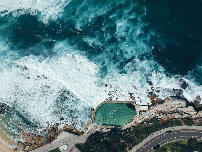 Bronte Beach Drone  Sydney Australia Sea Water Motion Wave Nature High Angle View Architecture Built Structure Beauty In Nature Sport Power Day Aquatic Sport Power In Nature Scenics - Nature Outdoors Breaking