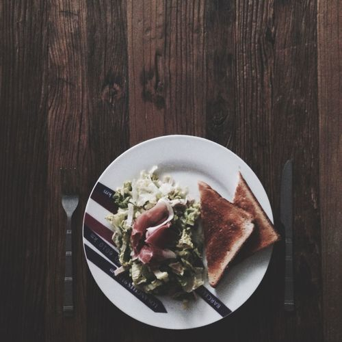 Directly Above Shot Of Bacon And Toasted Bread With Salad On Plate