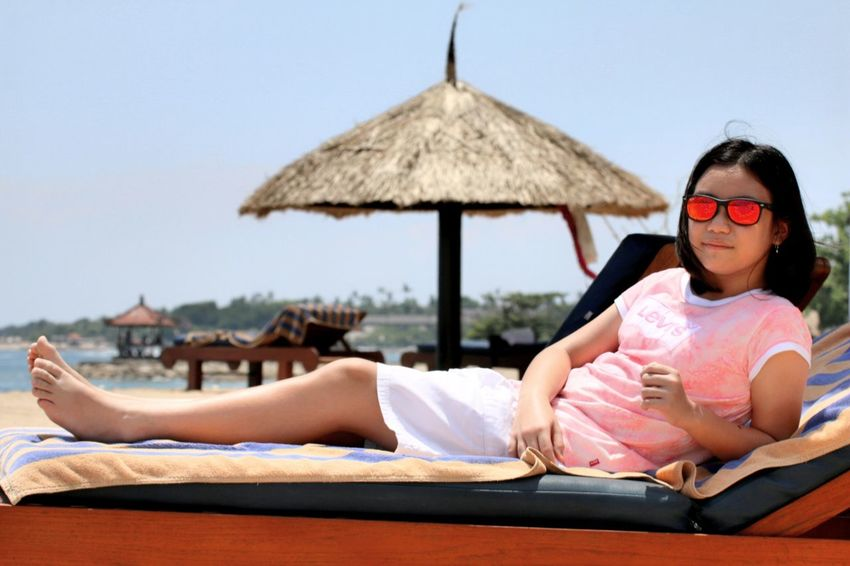 ❤ Bali.. Sunglasses Vacations Relaxation Summer Lying Down Leisure Activity Child Looking At Camera Travelling Kidsphotography Vacations Travel Photography Travel Destination Tourist Resort Beach Resort Hotel