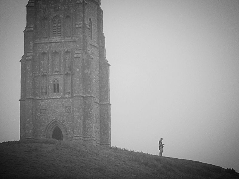 History Clear Sky Real People Day Outdoors Men Ancient Built Structure Standing One Person Architecture Full Length Lifestyles Travel Destinations One Man Only Sky Ancient Civilization Nature People Adult Thinking About Life Contemplating Life Glastonbury Tor