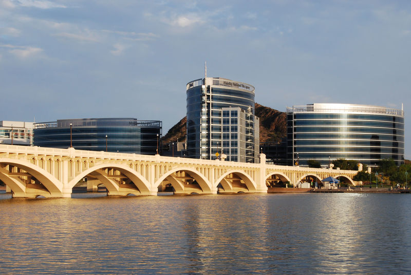 Tempe, Arizona, - USA - September 2, 2015: Time exposure of the newest modern office buildings at Tempe Town Lake with the Mill Ave Bridge in foreground. Architecture Arizona Building Built Structure Canal City City Life Cloud Cloud - Sky Day Façade Lake Modern Nature No People Office Building Outdoors Reflection Rippled River Sky Tempe Travel Destinations Water Tempe Town Lake