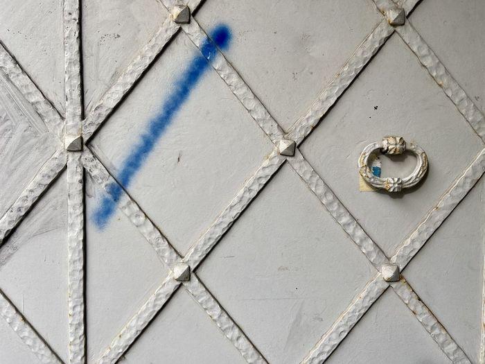 Close-up of metallic door on tiled floor