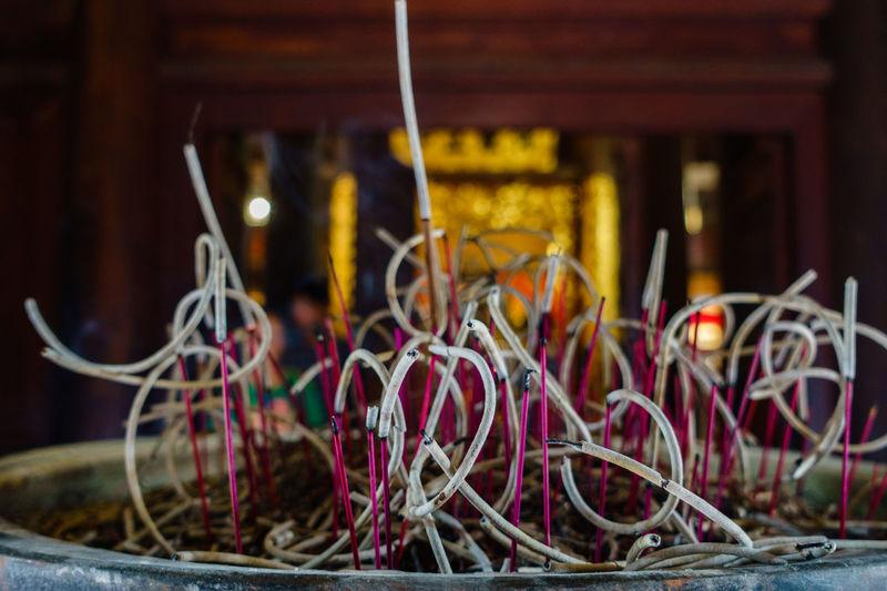 Incense sticks burning at temple